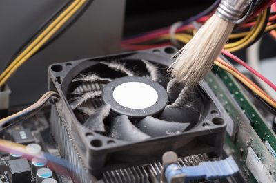 Cleaning a processor fan with a brush